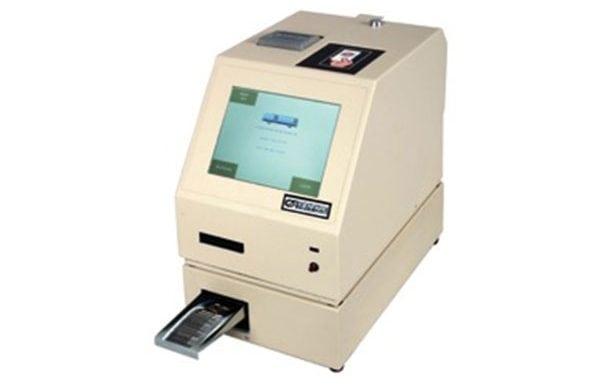Genfare's PEM (Printer/Encoder Machine) with drawer full product facing left