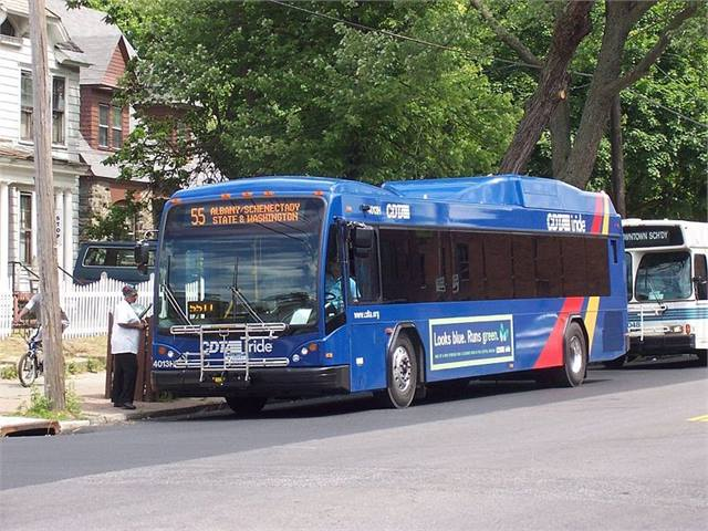 CDTA bus at a stop picking up passengers