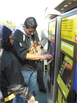 Riders purchasing tickets using Genfare's Vendstar farebox